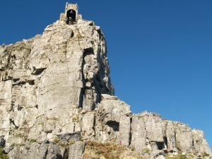 The cliff-top entrance for Table Mountain Cable Cars, and the death defying rock face you can see a ropeless rockclimber ascending