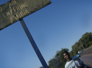 "Cliff under the 'entering Zambia"" sign"