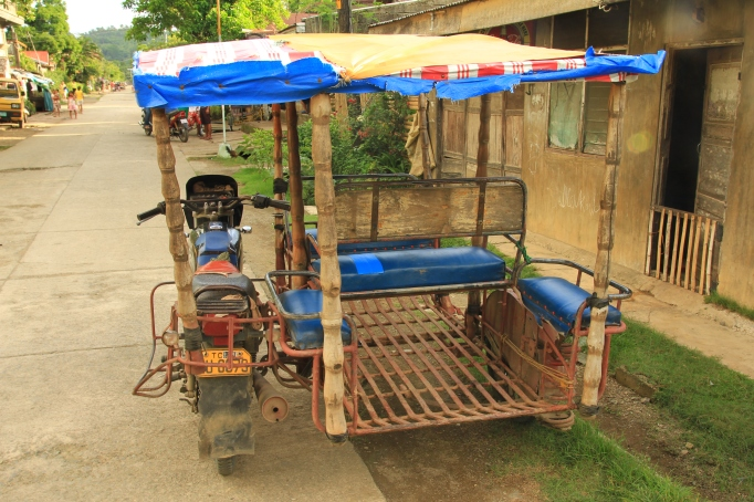 a tri-cycle, aka the Philippino taxi