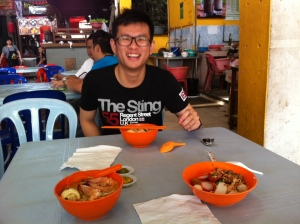 my couchsurf host and our Laksa breakfast