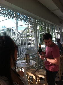 James mischievously pouring some champagne at the Regatta