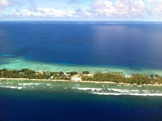 Majuro atoll, in the forefront and faintly in the background