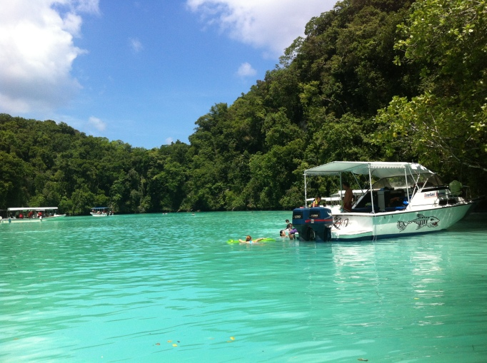 boatloads of Chinese tourists empty out at the Milky Way in Palau's Rock Islands