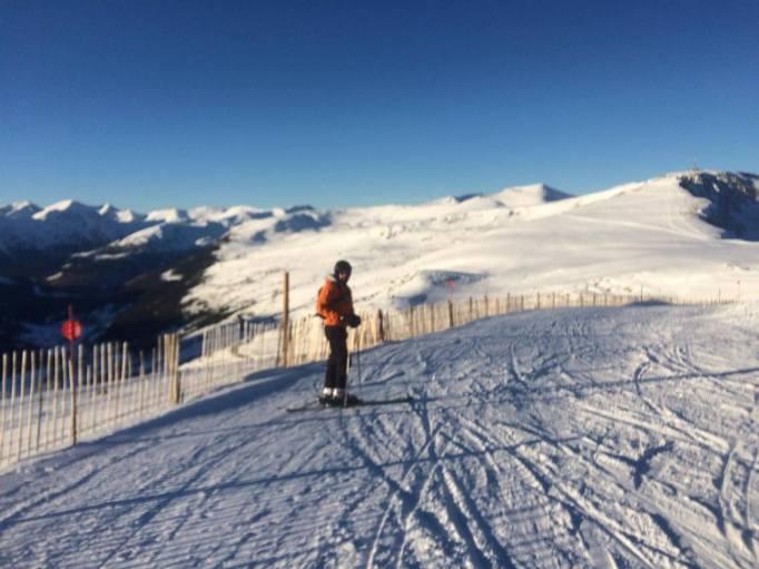 skiing under clear skies