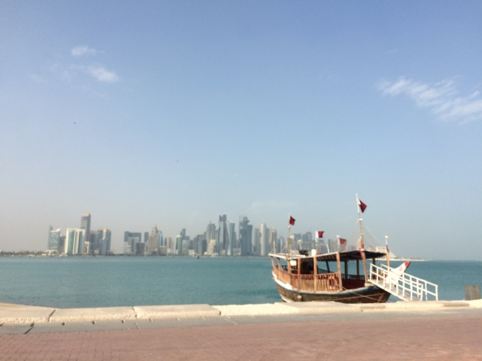 The old and the new, a traditional dhow boat and downtown Doha