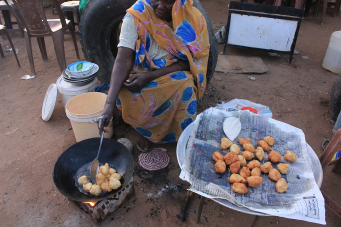 Street food in Sudan: fried and sugar coated donuts