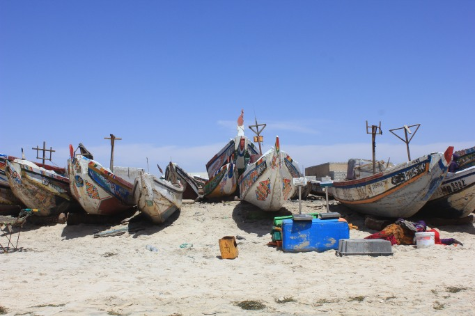 a beach full of boats