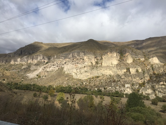 Drive past vineyards to the end of the road at Vardzia Cave Monastery