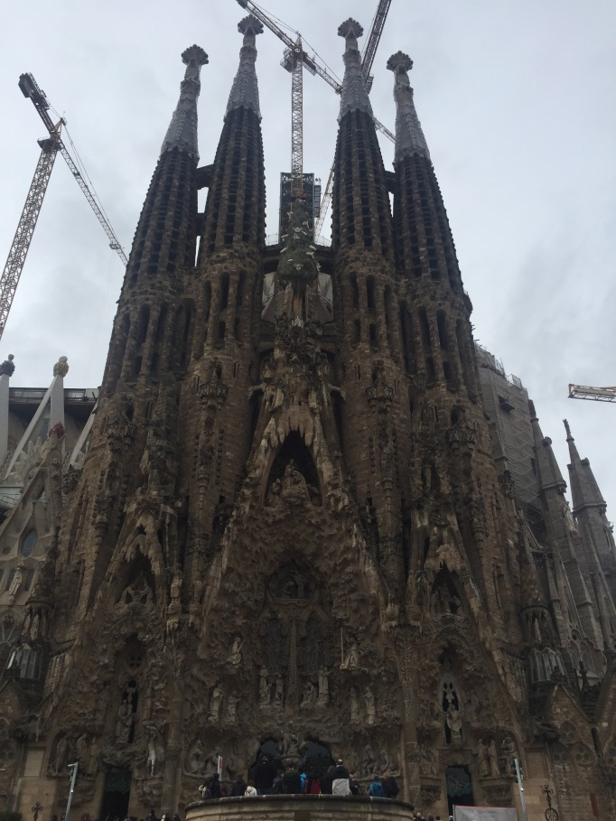 The Segrada familia cathedral, slightly shrouded by cranes and construction